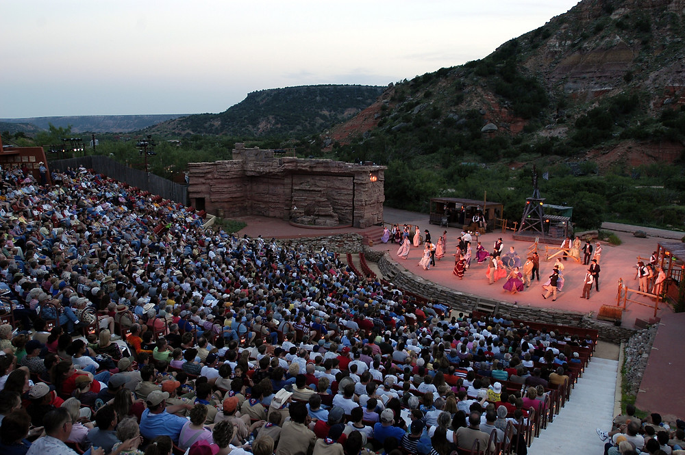 The audience watching dancing performers in TEXAS Outdoor Musical