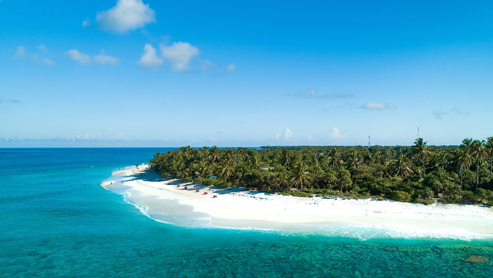 Snow-white beach on Fuvahmulah, South Pacific.