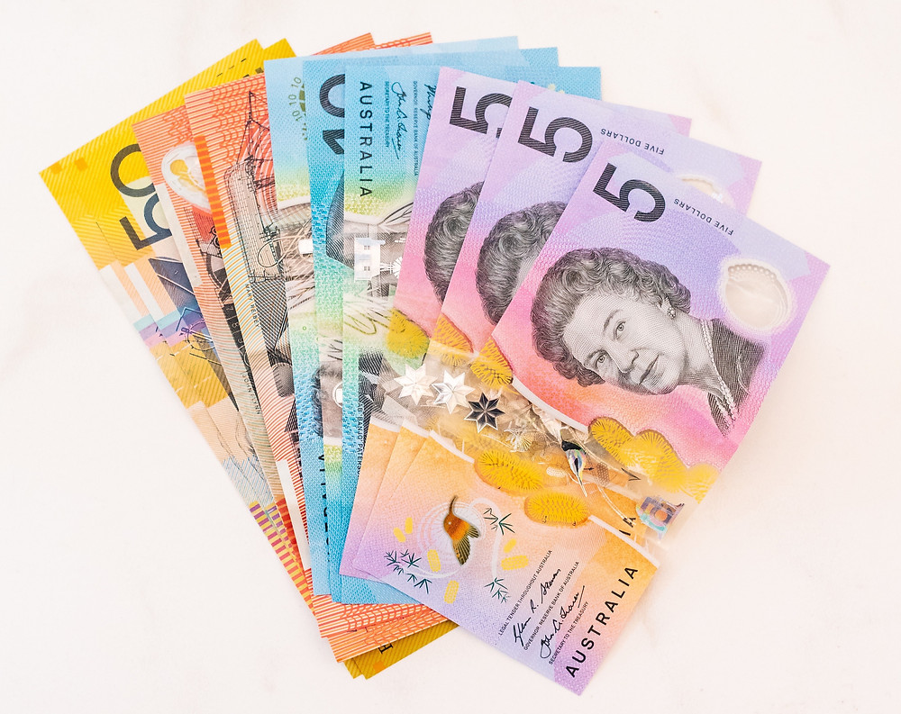 Australian money spread out on white surface