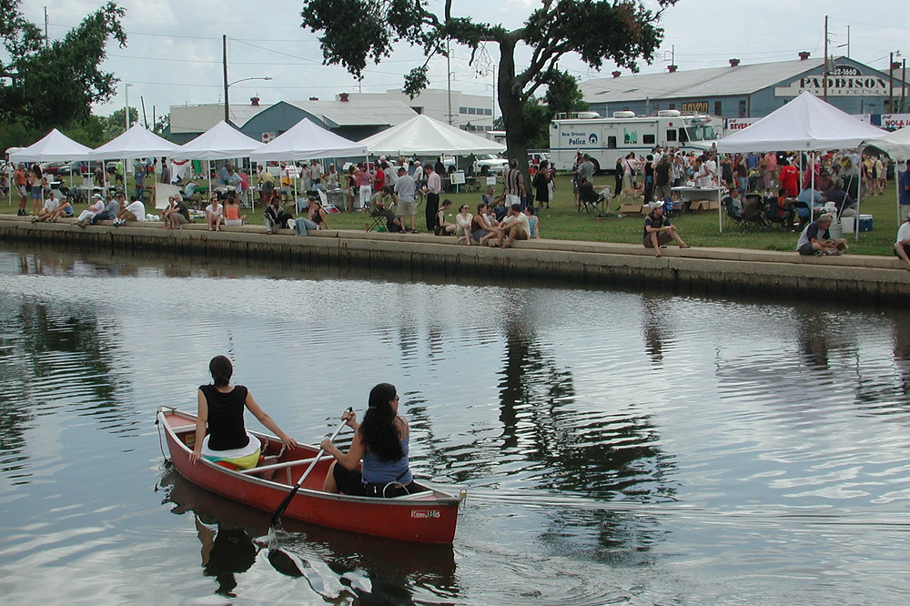 Two women in a red canoe during Bayou Boogaloo