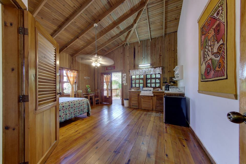 Wooden interior of a one bedroom suite at Posado Arco Iris on Roatan's Half Moon Bay