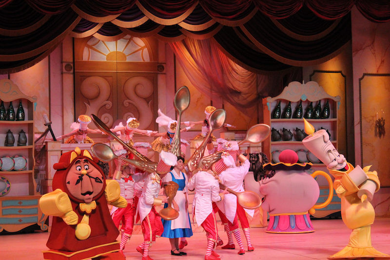 Scene with Belle, Cogsworth, Lumineer, Mrs. Potts and the Spoons in Beauty and the Beast Live on Stage