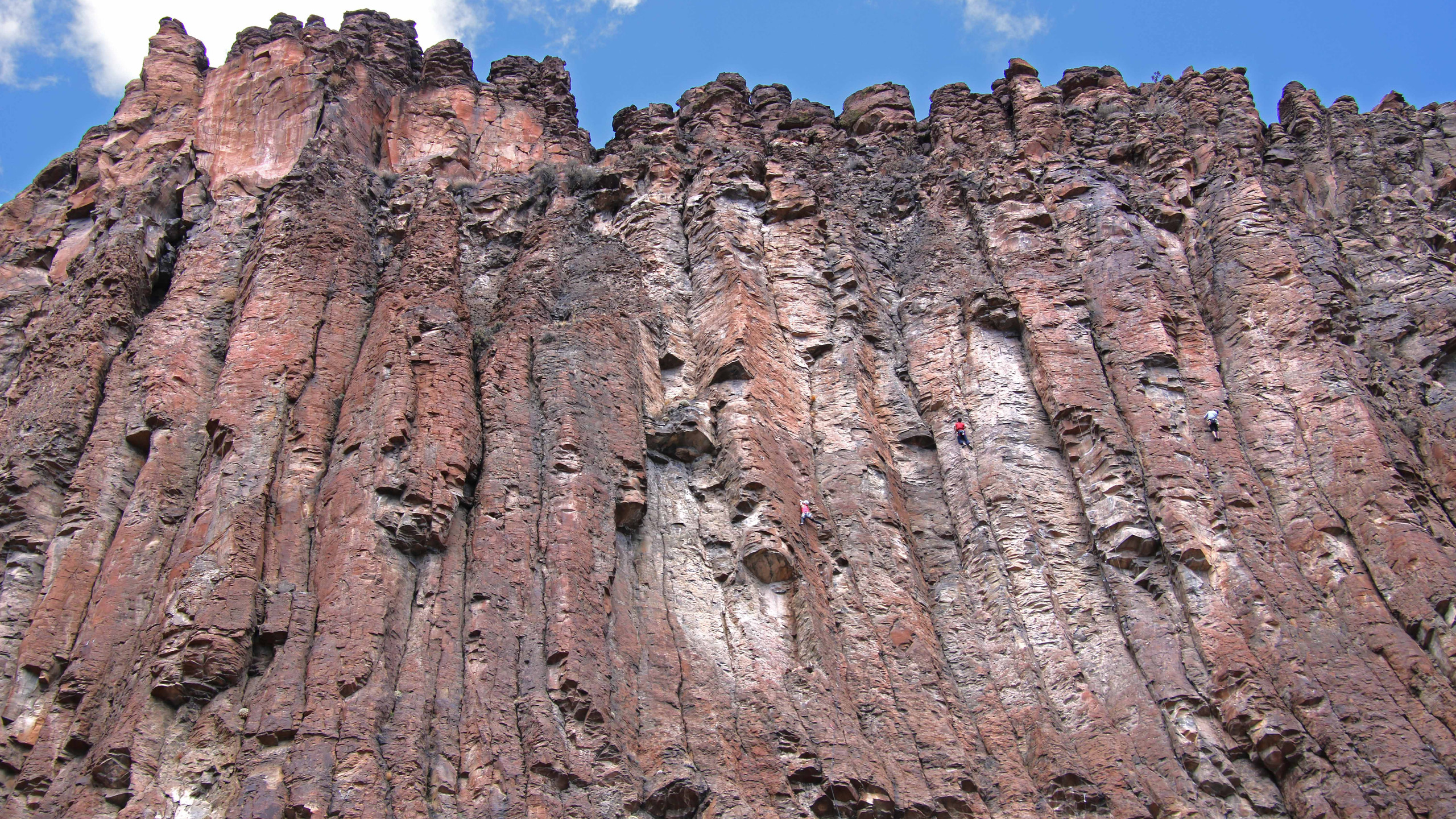 Red and white rock face of Diablo Canyon set against a blue sky