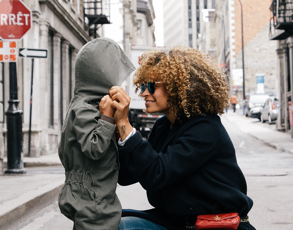 A mother talking to her son on a street in New York City
