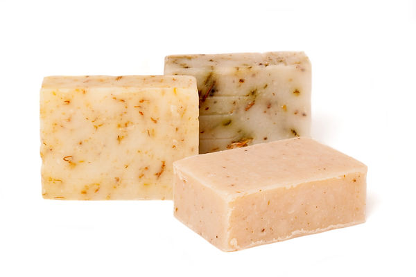 Three pieces of natural soap with dried