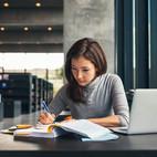 Girl Studying Book Laptop.jpg