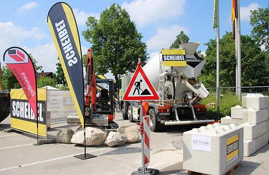 Beton;  Transportbeton; Kieswerk; Scheibel; Füssen, Bauunternehmen; Baufirma; Maurer; Messe; Wasserbausteine; Baggerbetrieb
