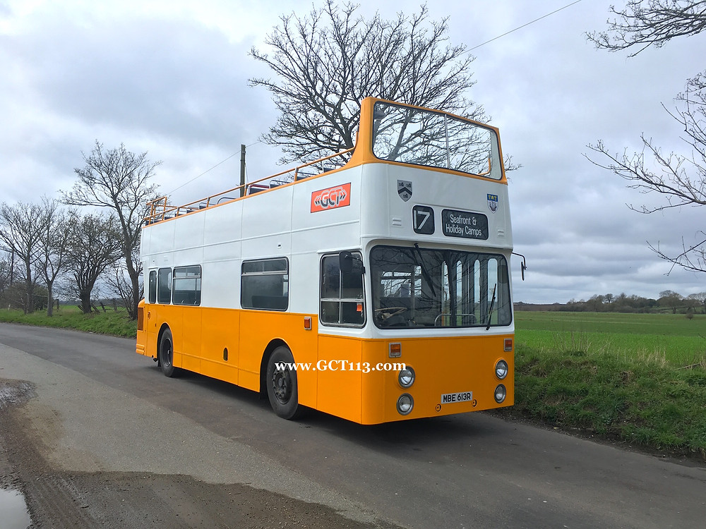 The contrast in orange between the stylised GCT fleet name sticker above the driver's cab and the orange paint can be seen here.