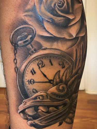 Rose clock and aztec art by Jorge
