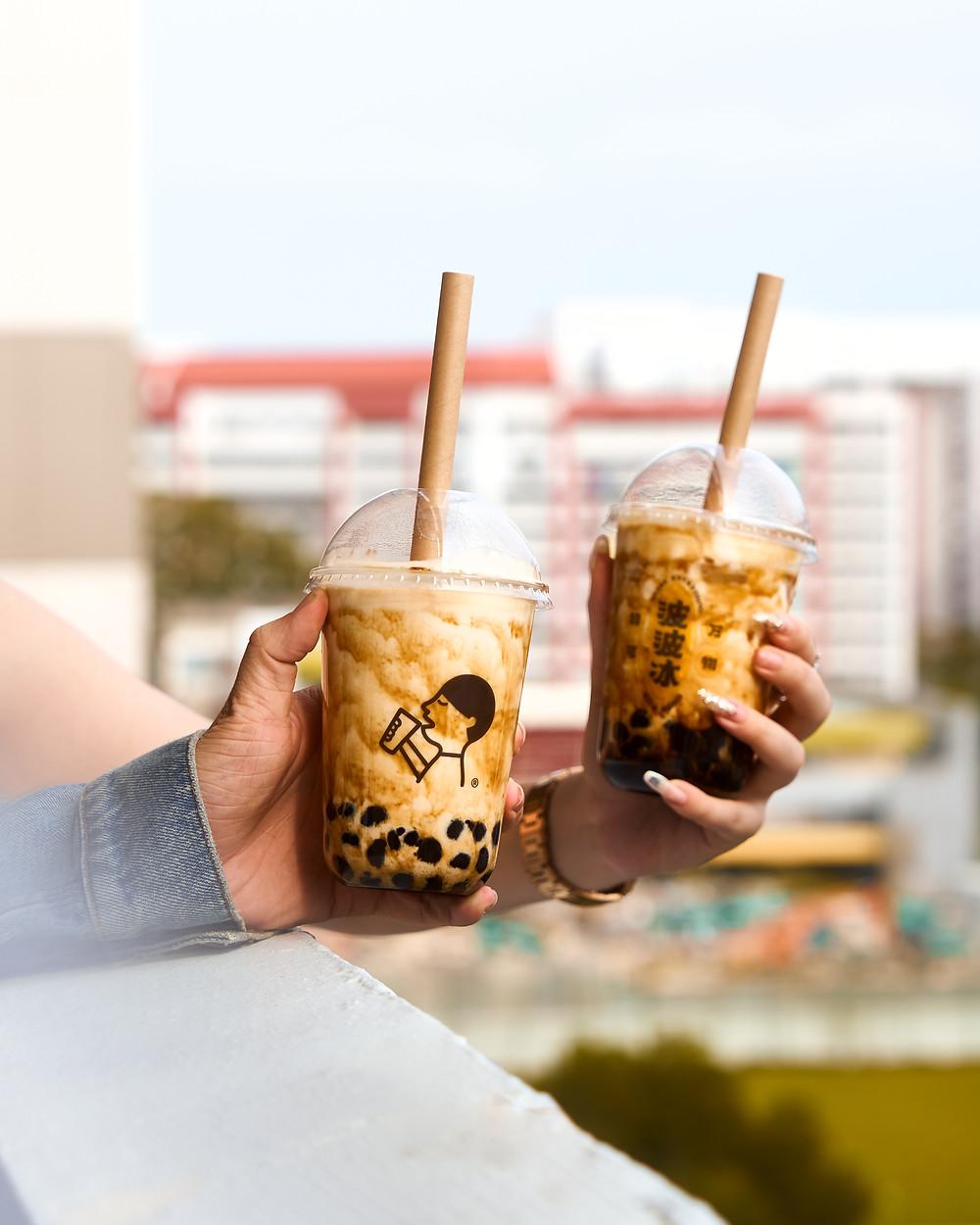 A shot for Hey Tea Singapore at a housing block at Tampines HDB TV Mural Art. A shot of Hey Tea's Brown Sugar Bubble Tea
