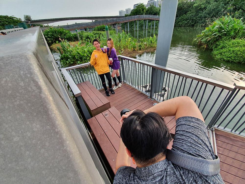 A photoshoot at Segkang Wetland Singapore with Hey Tea's Very Grape Cheezo Drink