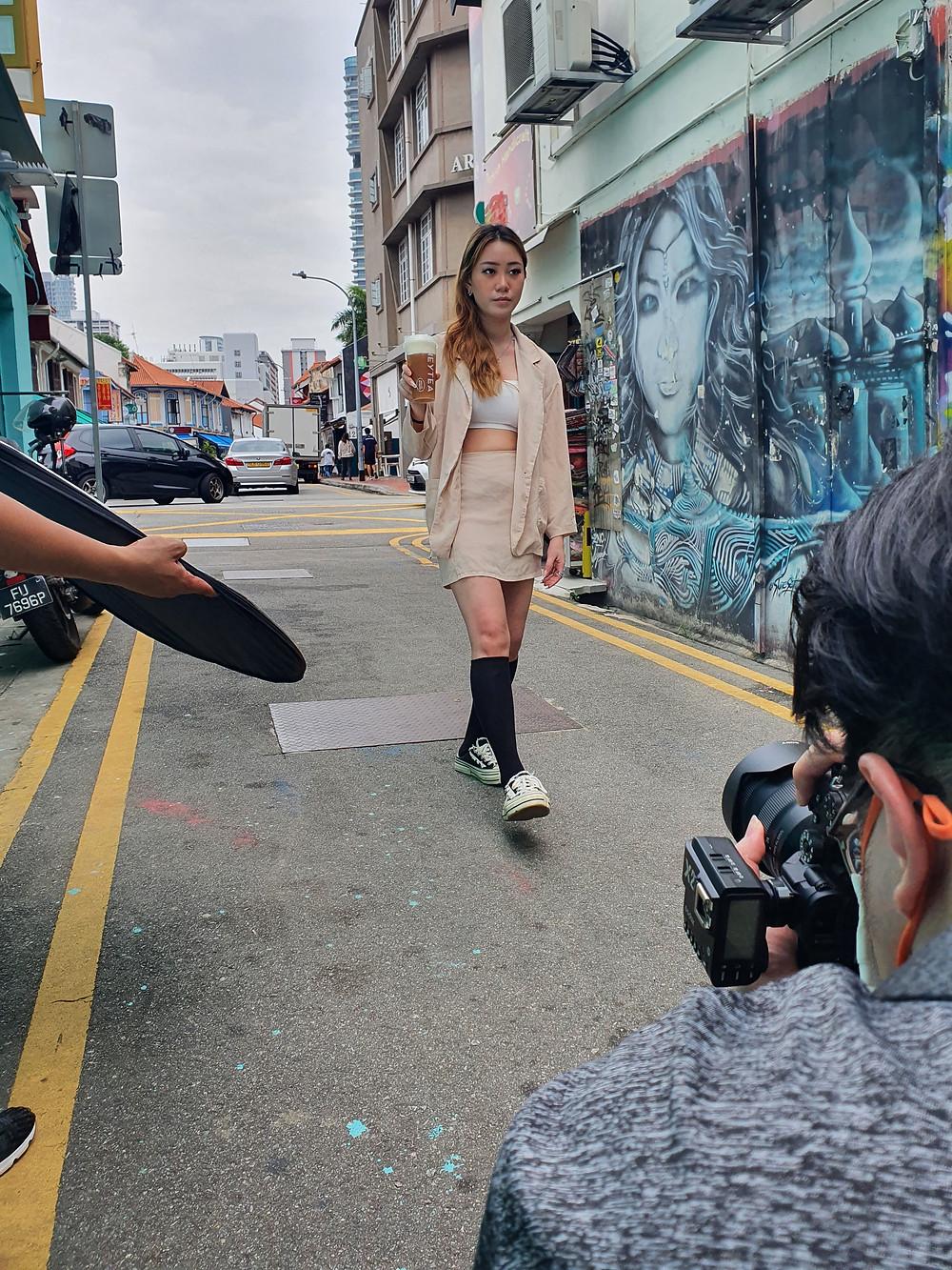 A movement Photoshoot of Rachel with the Hey Tea's King Fone Cheezo