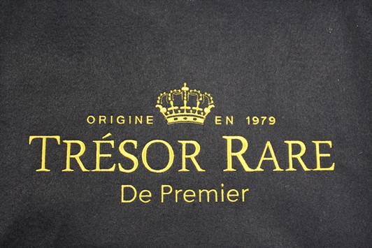 Tresor Rare embroidered logo corporate clothing