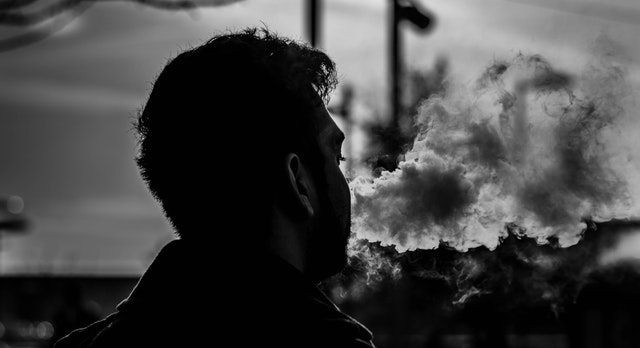 silhouette of man vaping