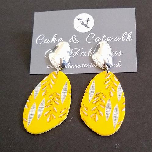 JCUK Yellow leaf earrings