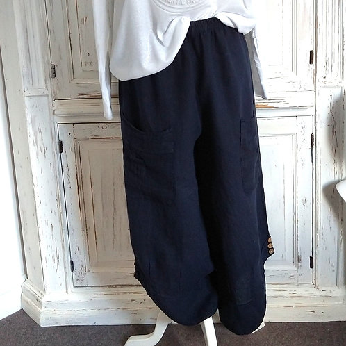 Button bottom loose shaped linen trousers