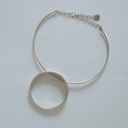 Hatti Big Ring Necklace on a Big Ring.