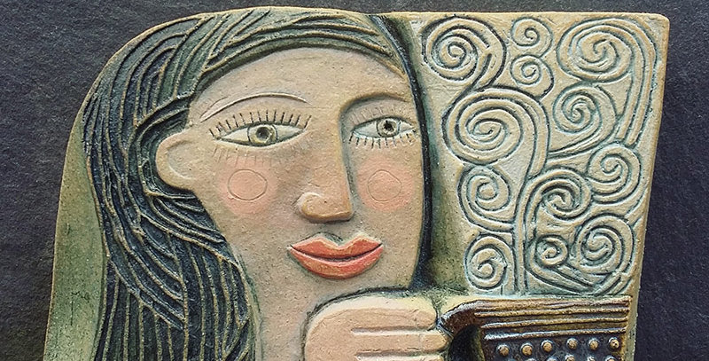 Woman with Hot Tea - ceramic relief by Hilke MacIntyre