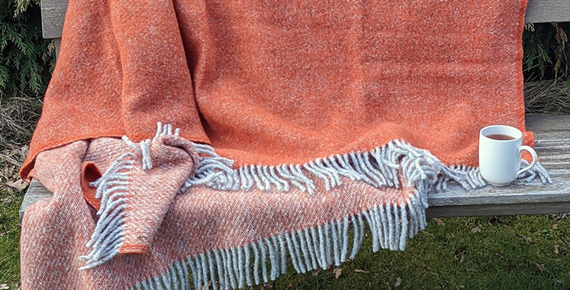 pure new wool throw in pumpkin & grey
