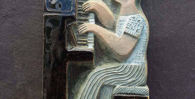 Piano - ceramic relief by Hilke MacIntyre