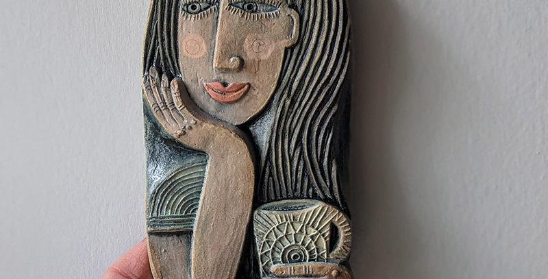 Taking a Break ceramic relief by Hilke MacIntyre