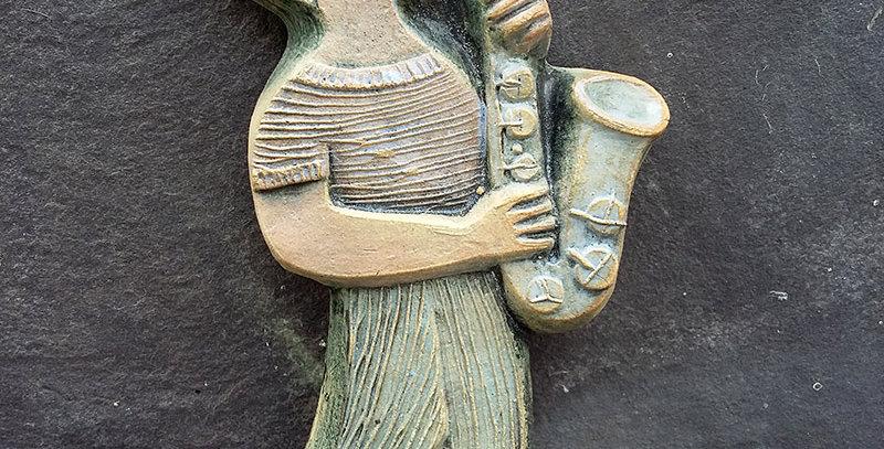 Saxophone - ceramic relief by Hilke MacIntyre