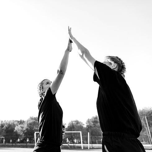 athletic-blonde-women-high-five_edited.j