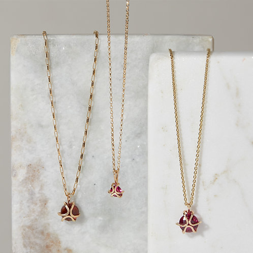 Iris Necklaces left to right: Hessonite Garnet, 5mm Ruby, 8mm Ruby