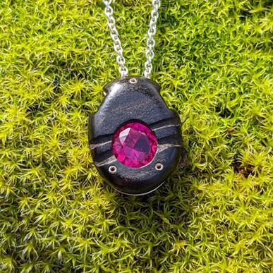 Ebony Neutron Pendant with Ruby