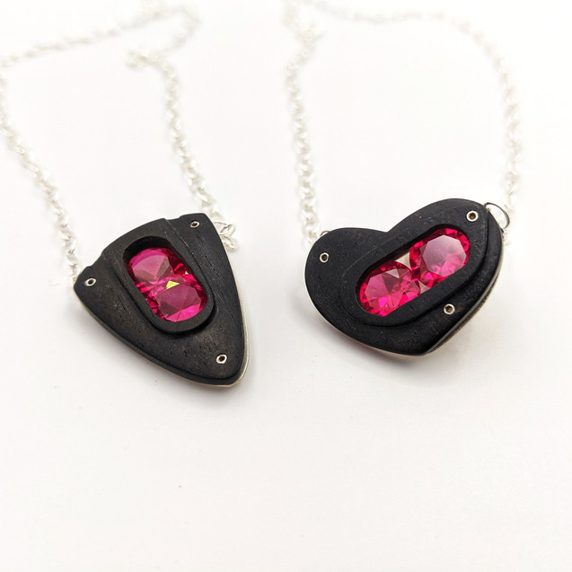Ebony and Ruby Handcarved Pendants Embark and Bond with Dooorway and Window Details