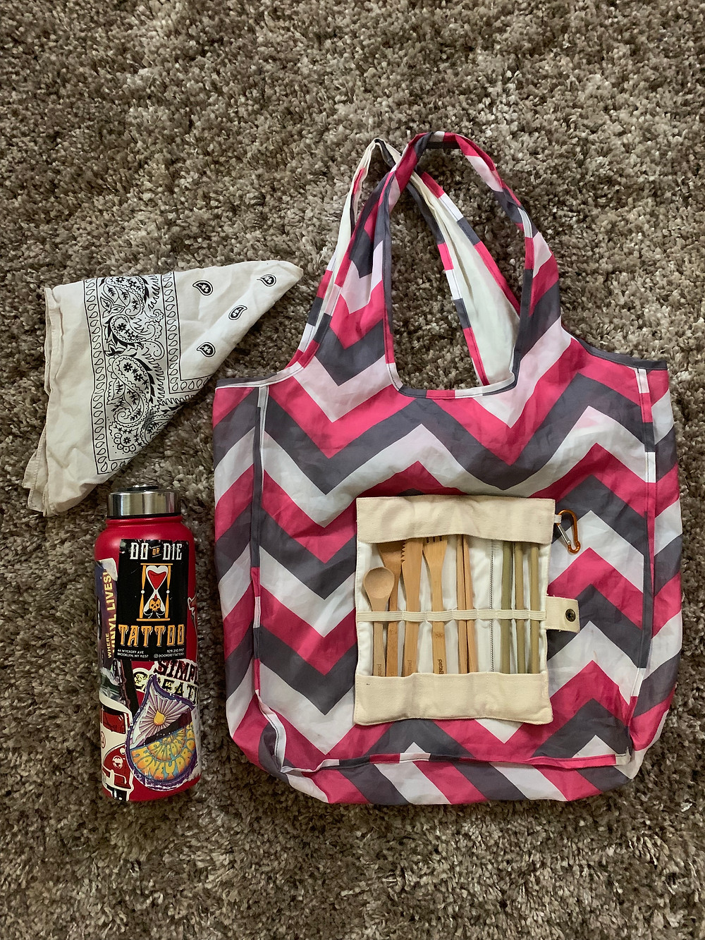 A reusable bag, a handkerchief, a stainless steal bottle, and set of bamboo silverware to encourage those to reduce waste.