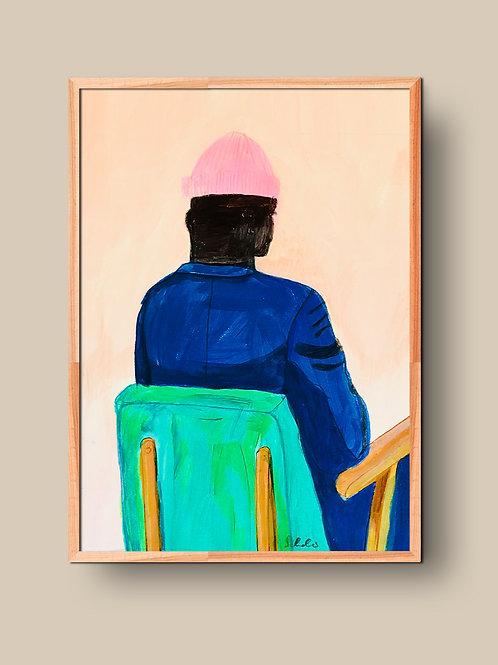 Blaue Jacke auf grünem Stuhl