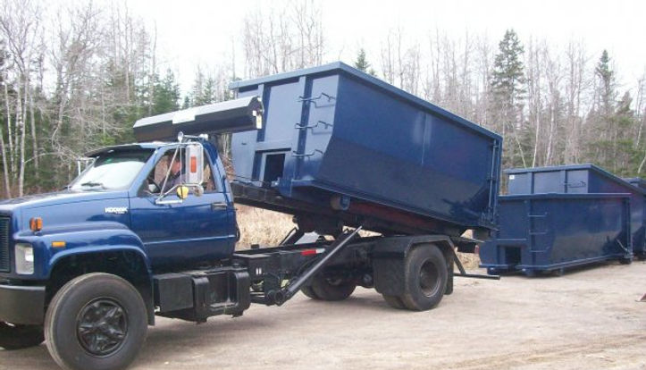 Ohio Brook Disposal truck delivering roll-off rental.