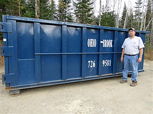 Ohio Brook Disposal owner Shane Curtis stands next to roll-off available for rental.