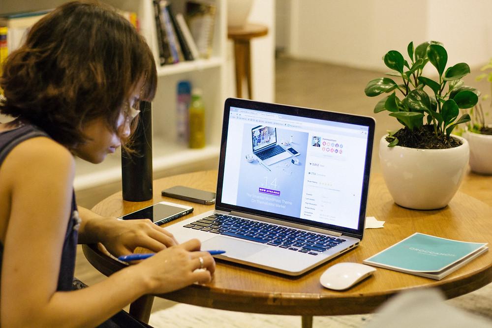 Woman sitting at a laptop.