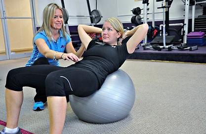 Jenn Allen teaching an abdominal exercise at the gym