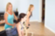 Jenn teaching Pilates clients