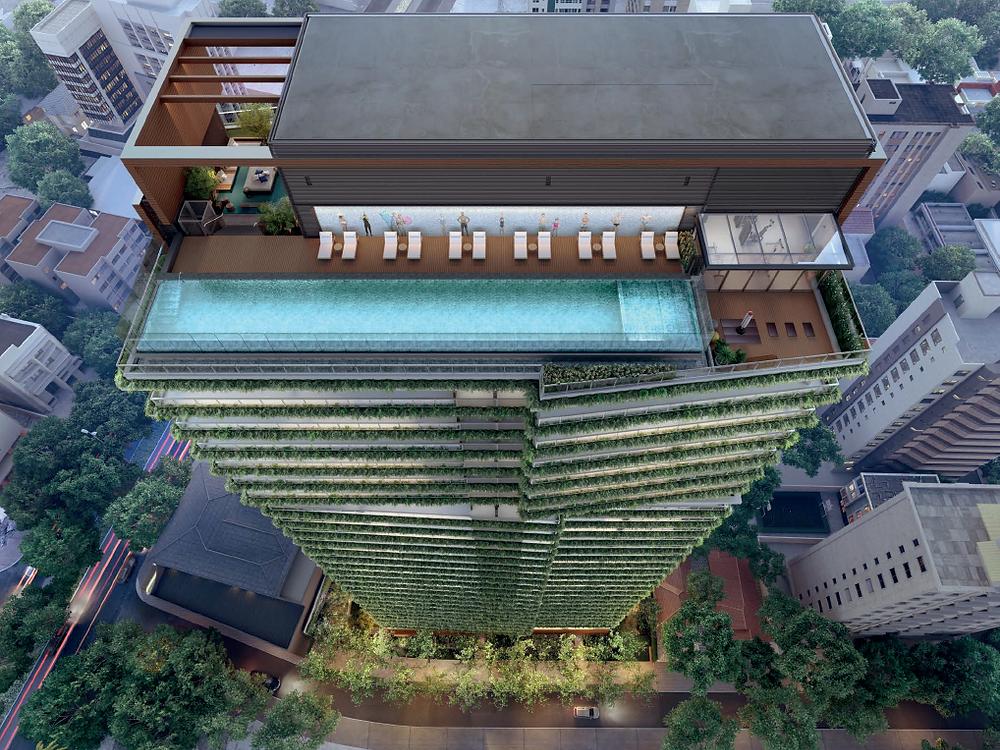 Imagem aérea do rooftop com painel de Vick Muniz junto à piscina aquecida no Alameda Jardins