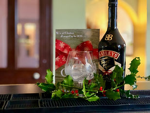 Bottle of Baileys with Holly leaves .jpg