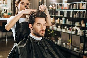 bigstock-Beautiful-Young-Hairdresser-Cu-