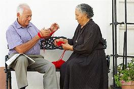 Volunteer visiting elderly man