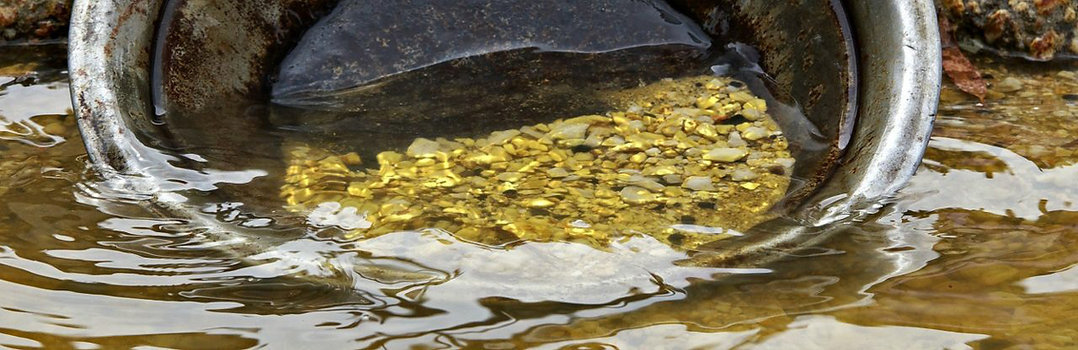 Gold in pan in water