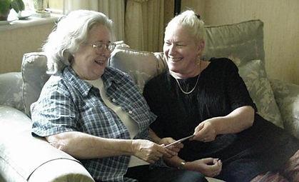 Volunteer visiting elderly client