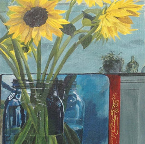 Sunflowers in a glass jar