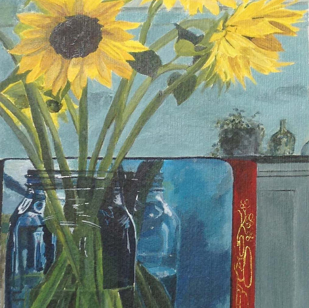 Sunflowers in a glass jar
