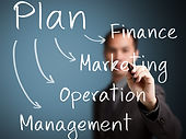 business man writing business plan conce