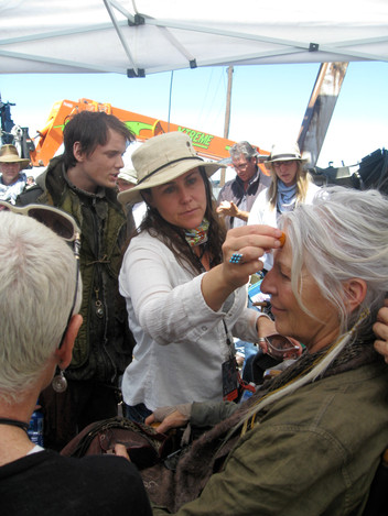Touching up Jane Alaxander on the set of Terminator Salvation with Anton Yelchin in the back ground.  Antons passing was heartbreaking. He was a wonderful person and extremely talanted. He is missed by everyone.