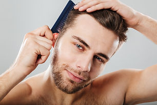 close-up-portrait-smiling-man-combing-his-hair.jpg