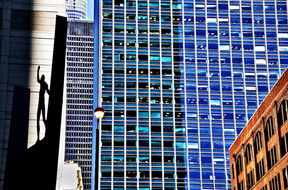 BLUE SKYSCRAPER /SHADOW FIGURE