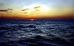 Golden Sunset Over Deep Blue Ocean